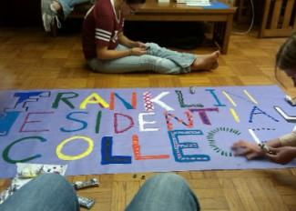 Students decorating FRC welcome sign