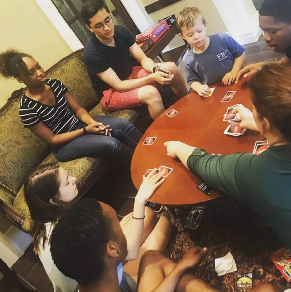 Family game night in Rutherford parlor