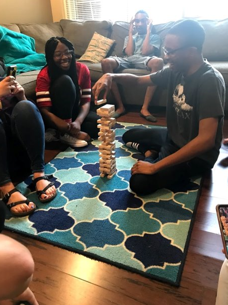 FRC members playing Jenga at cookie night
