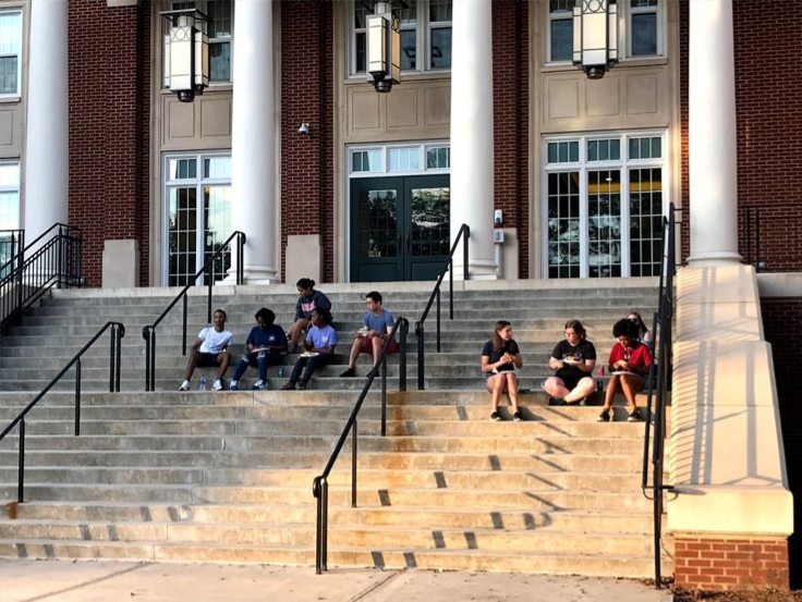 FRC members enjoy a cookout on steps of Rutherford Hall
